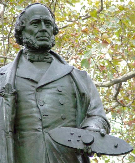 A statue of John Ericsson, the <em>Monitor</em>'s inventor, in Battery Park, New York City, with a <em>Monitor</em> model in hand