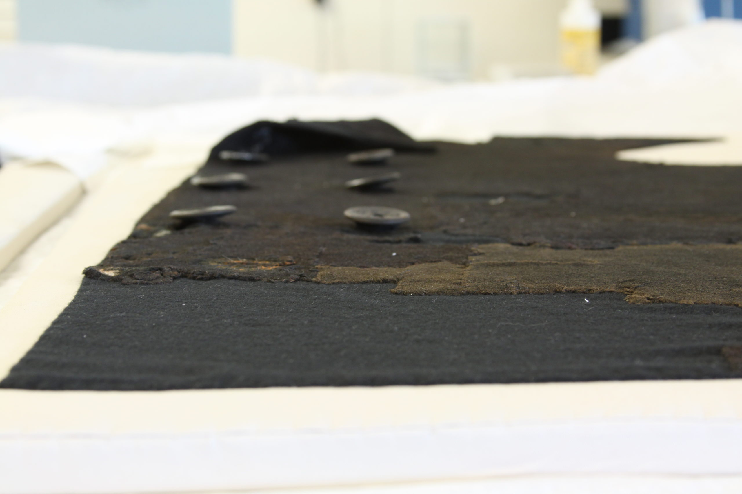 Conservation work on an officer's coat from the USS <em>Monitor</em> wreckage