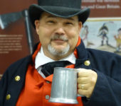 Eric Jeanneret with a cup of grog