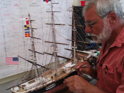 Mike Amicone at work on a model ship