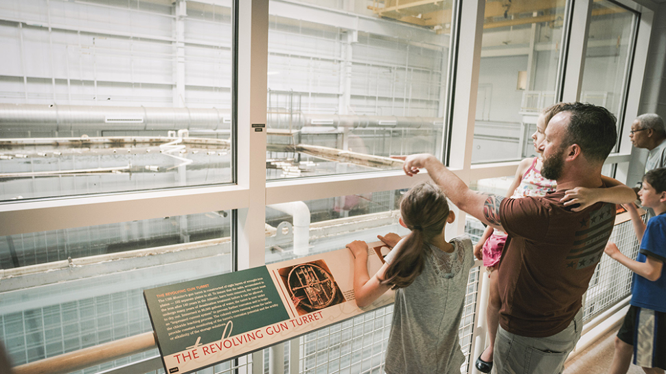 Family viewing the conservation tanks